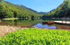 Boats. Two wooden boats on a river in the mountains Stock Photos