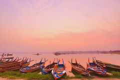 Boats at Ubeng Bridge in Myanmar. Sun rises at Ubeng bridge in Myanmar Stock Photos