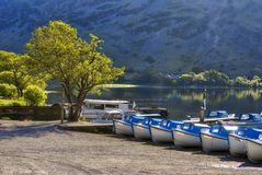 Boats on Ullswater shore Royalty Free Stock Photos