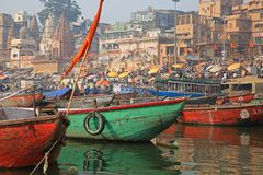 Colorful Ganges River Scene, Varanasi, India. Boats and umbrellas add color to the crowded bank of the sacred Ganges River in Varanasi, India Royalty Free Stock Photo