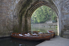 Boats under archway on River Wear, Durham City. Royalty Free Stock Images