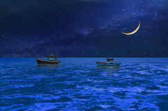 Boats under the crescent moon midst the blue ocean Royalty Free Stock Photos