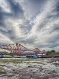 Boats under the Forth Rail Bridge in Edinburgh Stock Image
