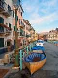 Boats under the houses Royalty Free Stock Photos