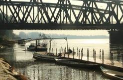Boats under iron bridge Stock Image