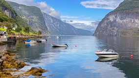 Boats in Undredal, Norway. Boats in Undredal with the fjord in the background, Norway Royalty Free Stock Images