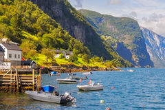 Boats in Undredal, Norway. Boats in Undredal with the fjord in the background, Norway Royalty Free Stock Image