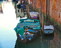 Boats in Venice. Romantic view of a corner of the popular side of Venice, less touristic but more lively, with boats floatig on the still waters of a canal Royalty Free Stock Image