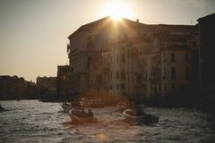 Boats in Venice, Italy at sunset Stock Image