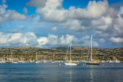 Boats and view of hills across Beacon Bay  Royalty Free Stock Image