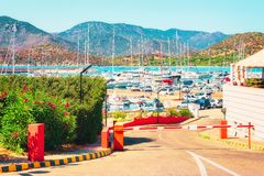 Boats and Villasimius Port in Mediterranean Sea Sardinia Island. Boats and Beautiful Port of Villasimius in the Bay of the Blue Waters of the Mediterranean Sea royalty free stock photos