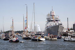 Boats with visitors to the sail. AMSTERDAM, THE NETHERLANDS, 20 AUGUST 2015 : Boats with visitors to the sail with a large Dutch navy ship during the great Royalty Free Stock Images