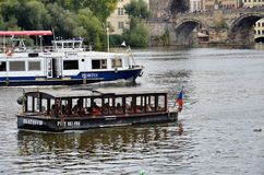Boats in the Vltava river Stock Images
