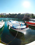 Boats at Voulismeni lake in Agios Nikolaos. Crete Stock Photos