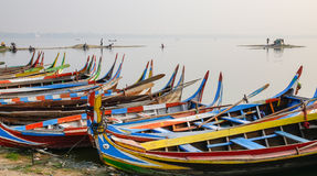 Boats waiting for passengers on lake in Mandalay, Myanmar Royalty Free Stock Photo