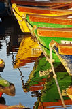 Boats in water. Colorful boats and their reflection Royalty Free Stock Photo