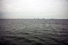 Boats on water in cloudy weather Royalty Free Stock Images