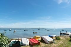 Arcachon Bay, France, view over the bay at summer. Boats on water and row boats at seaside Royalty Free Stock Image