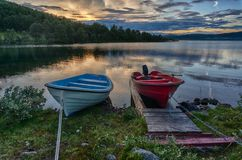 Romantic lake landscape in europe. Boats and water in silence and romance Europe travel Royalty Free Stock Image