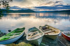 Romantic lake landscape in europe. Boats and water in silence and romance Europe travel Royalty Free Stock Photo
