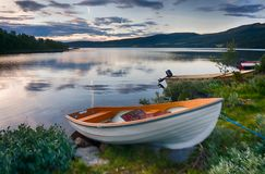 Romantic lake landscape in europe. Boats and water in silence and romance Europe travel Stock Image