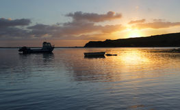Boats on the water at sunrise Stock Photography