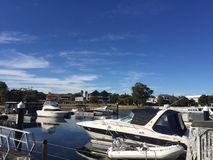 Boats on the water on a Winters day on Dolphin Quay In Mandurah stock photos