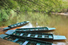 Boats waterfront. Long tail boat to paddle in the river, take on water, the water community life and serve as a vehicle to take tourists on their way of life Royalty Free Stock Image