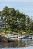 Boats on waterfront. Boats on rocky waterfront of Swedish town. Summer season Royalty Free Stock Photography