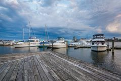 Boats on the waterfront at sunset in Fells Point, Baltimore, Maryland stock photo