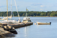 Boats on waterfront. Of Swedish city. Summer season Royalty Free Stock Image