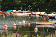 Boats on waterfront. Of Swedish park. Summer season Royalty Free Stock Photo