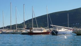 Boats on the waves. Boats rock on the waves in the port stock video footage