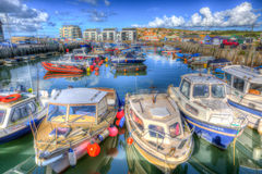Boats in West Bay harbour Dorset England UK on calm summer day Stock Photo