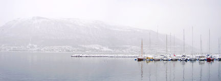 Boats in a winter panorama on harbour. Background Royalty Free Stock Image
