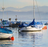 Boats after the winter in the warm February evening. Royalty Free Stock Images