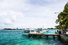 Boats at wooden dock, Male International Airport, Male, Maldives Royalty Free Stock Photos