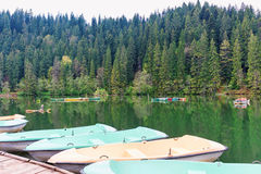 Boats at wooden relaxing area on the sovata lake Stock Photos