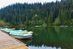 Boats at wooden relaxing area on the sovata lake Royalty Free Stock Photo
