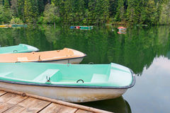 Boats at wooden relaxing area on the sovata lake Stock Photography