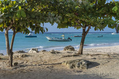 Boats at Worthing Beach Barbados Stock Image