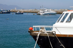 Boats and yacht moored in a harbour Stock Photography