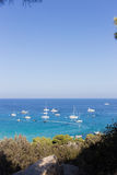 Boats and yachts anchored close to the sea shore in blue lagoon Royalty Free Stock Image