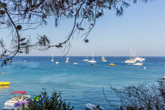 Boats and yachts anchored close to the sea shore in blue lagoon Stock Photo