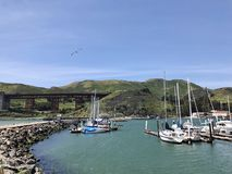 Boats and yachts docked in cove in Sausalito, California. Boats docked in San Francisco Bay Area, on sunny stock photo