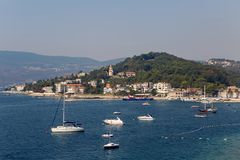 Boats and yachts docked at the pier in the Bay of Montenegro Royalty Free Stock Images