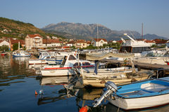 Boats and yachts in the harbor, beautiful summer landscape. Tivat marina, Montenegro. stock photos