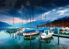 Boats and yachts on lake Thun at night. Royalty Free Stock Photos