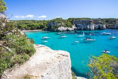 Boats and yachts on Macarella beach, Menorca, Spain Stock Images