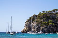 Boats and yachts on Macarella beach, Menorca, Spain. Panorama view of Macarella beach in Menorca, Balearic Islands, Spain Royalty Free Stock Image